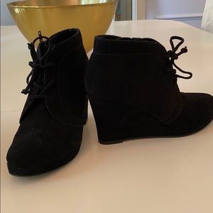 Black suede wedge shoes.